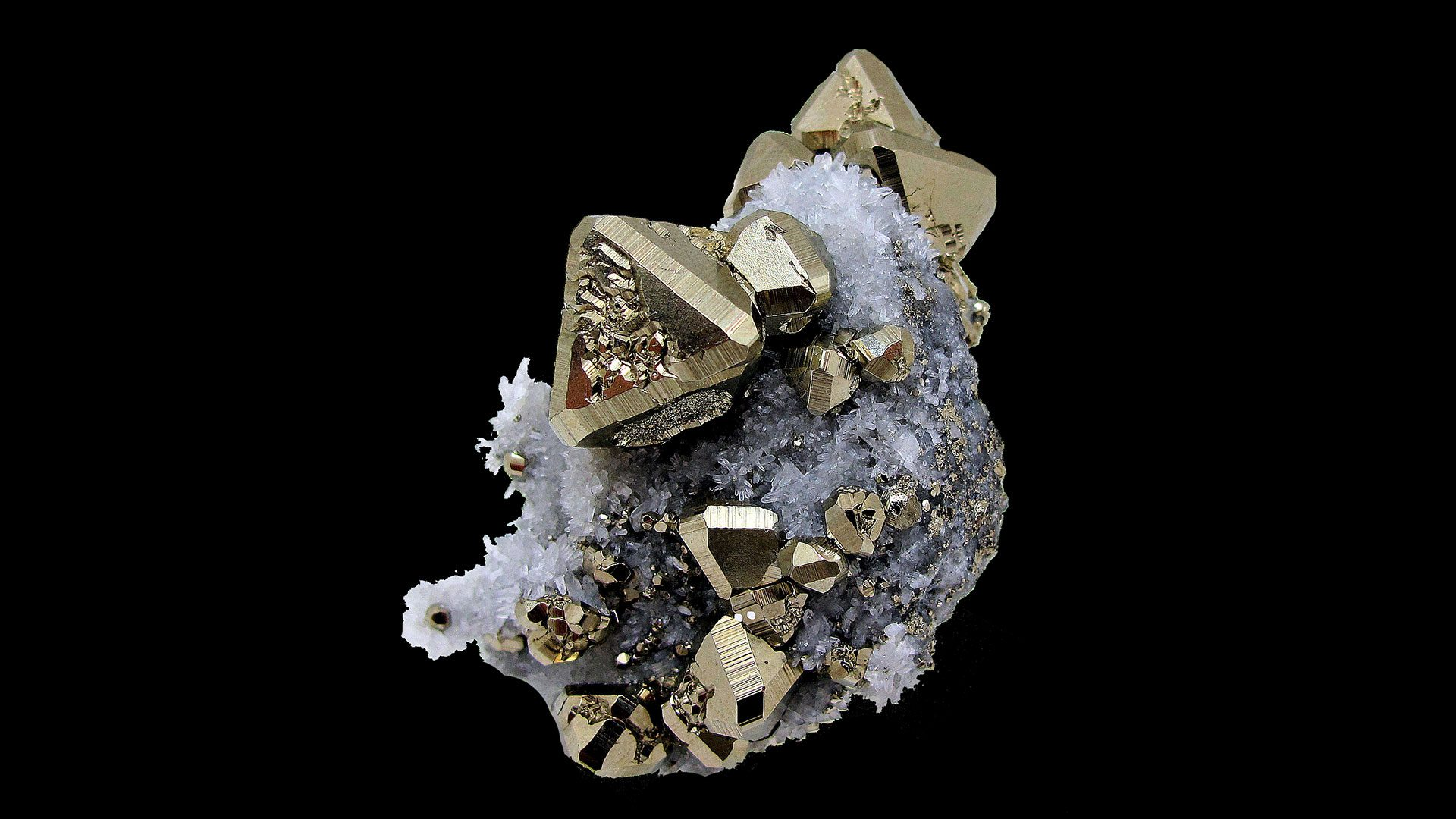 Pyrite Properties and Meaning - Original Photograph by Carles Millan (Background edited by Crystal Information)