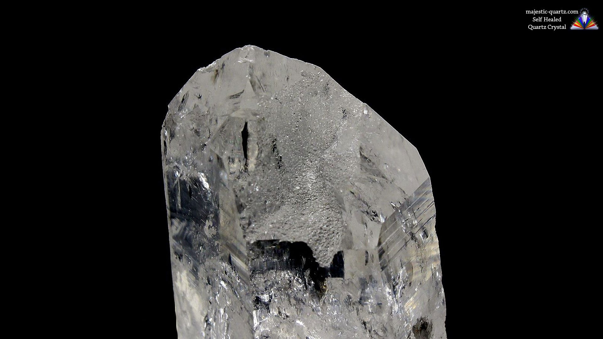 Self Healed Quartz Crystal, Termination faces had been damaged and self repaired - Photograph by Anthony Bradford
